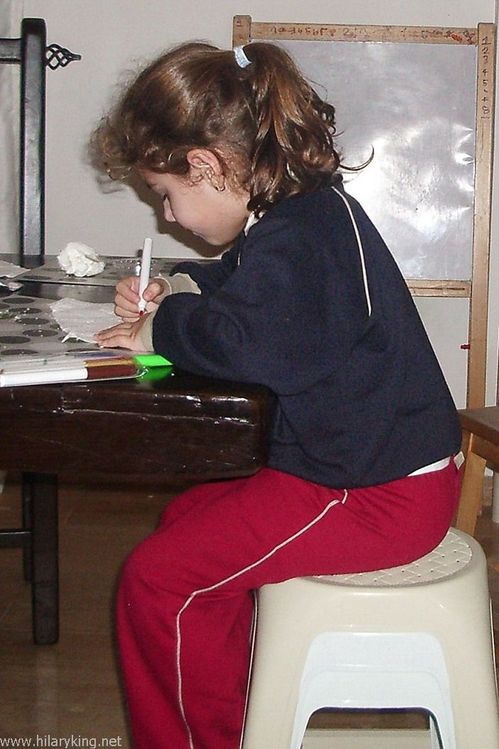 Child sitting drawing.jpg
